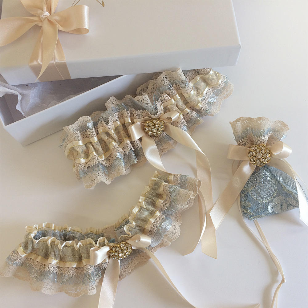The most beautiful nude, champagne, gold wedding garters...