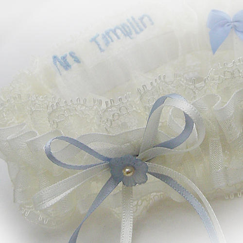 Nottingham lace wedding garter with blue flower