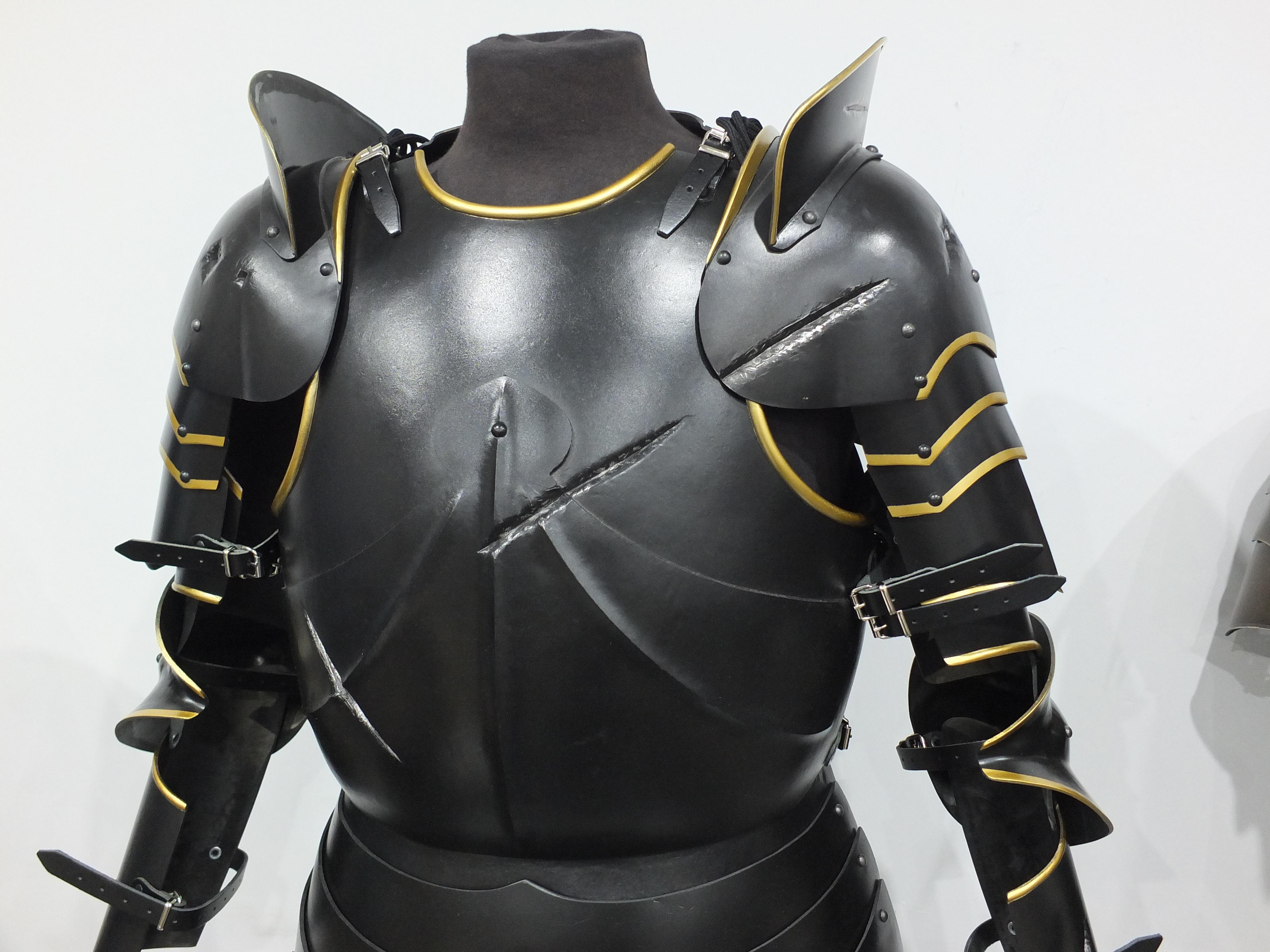 German armour set with battle damage in black and gold finish