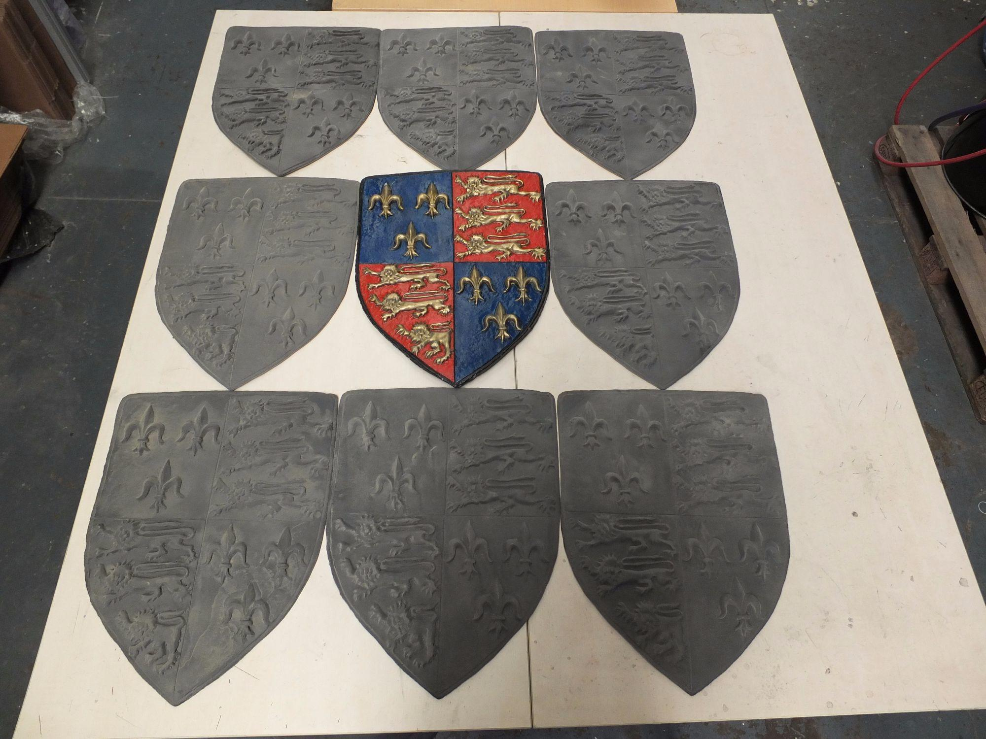 Shield moulded and reproduced.