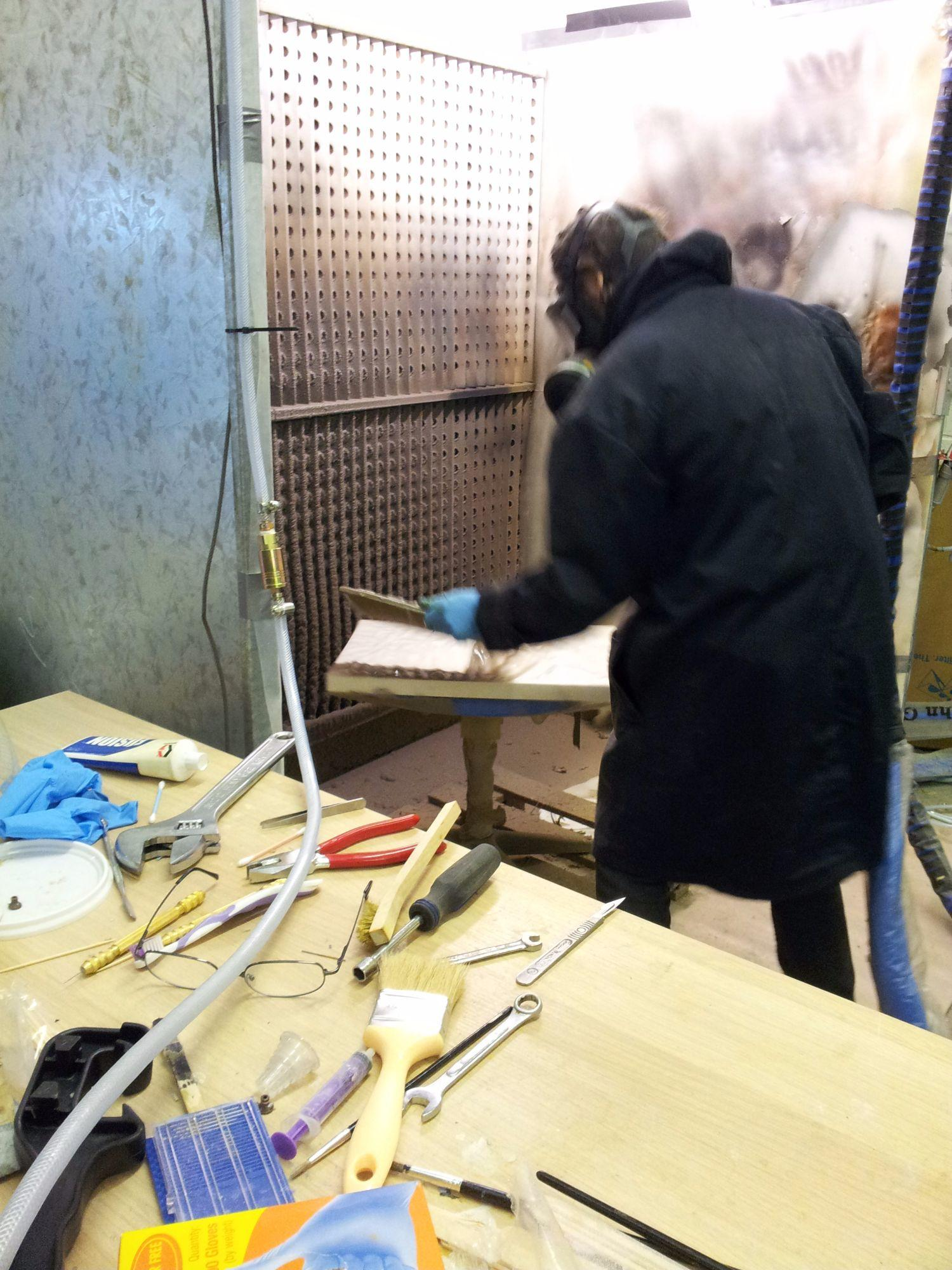 Spraying into a mould