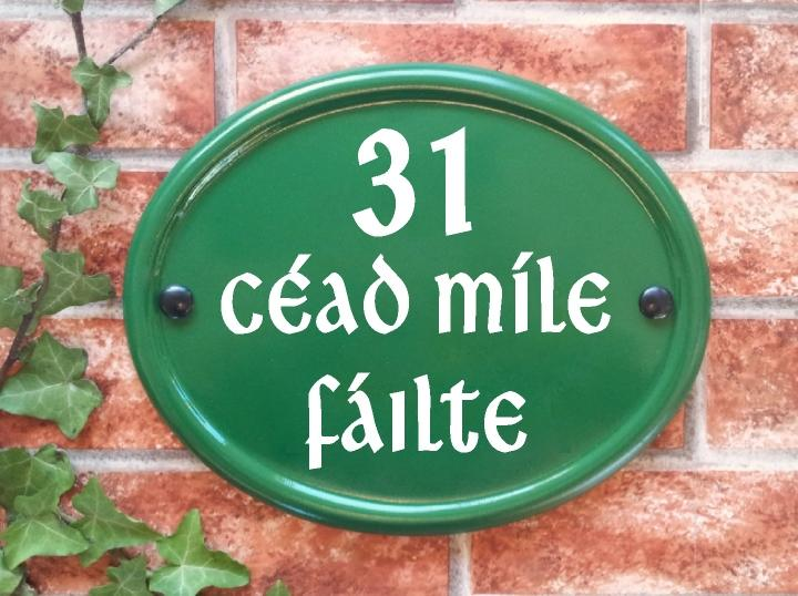 Oval house plaque in green with number and Gaelic house name 260mm x 210mm