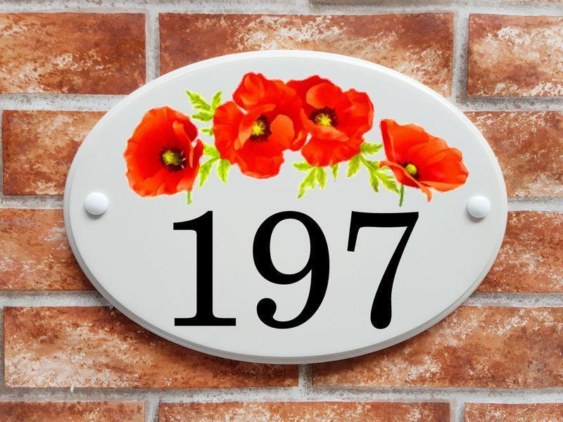 Large door number sign with poppies