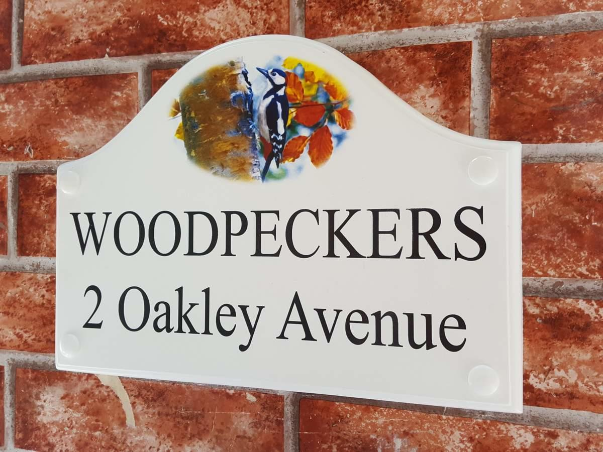 house sign with woodpecker pictorial design