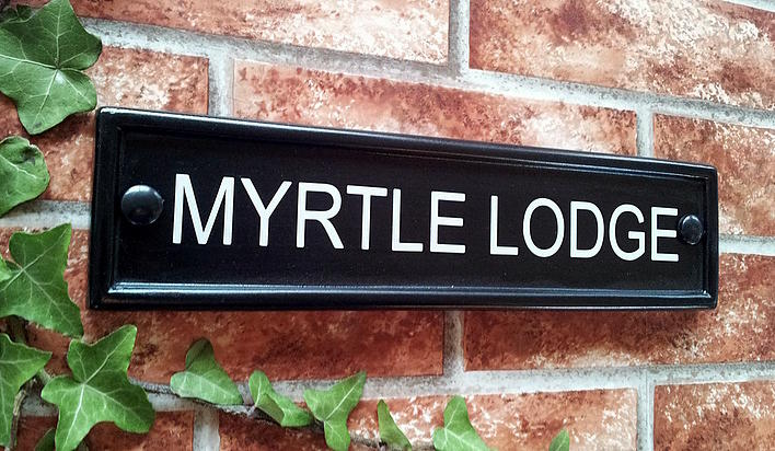 Black rectangular house sign with house name 292mm x 70mm