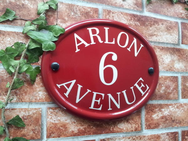 Burgundy reflective oval sign with number and address line 260mm x 210mm