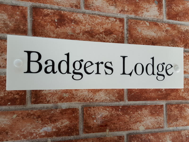 White house plaque with Badgers Lodge