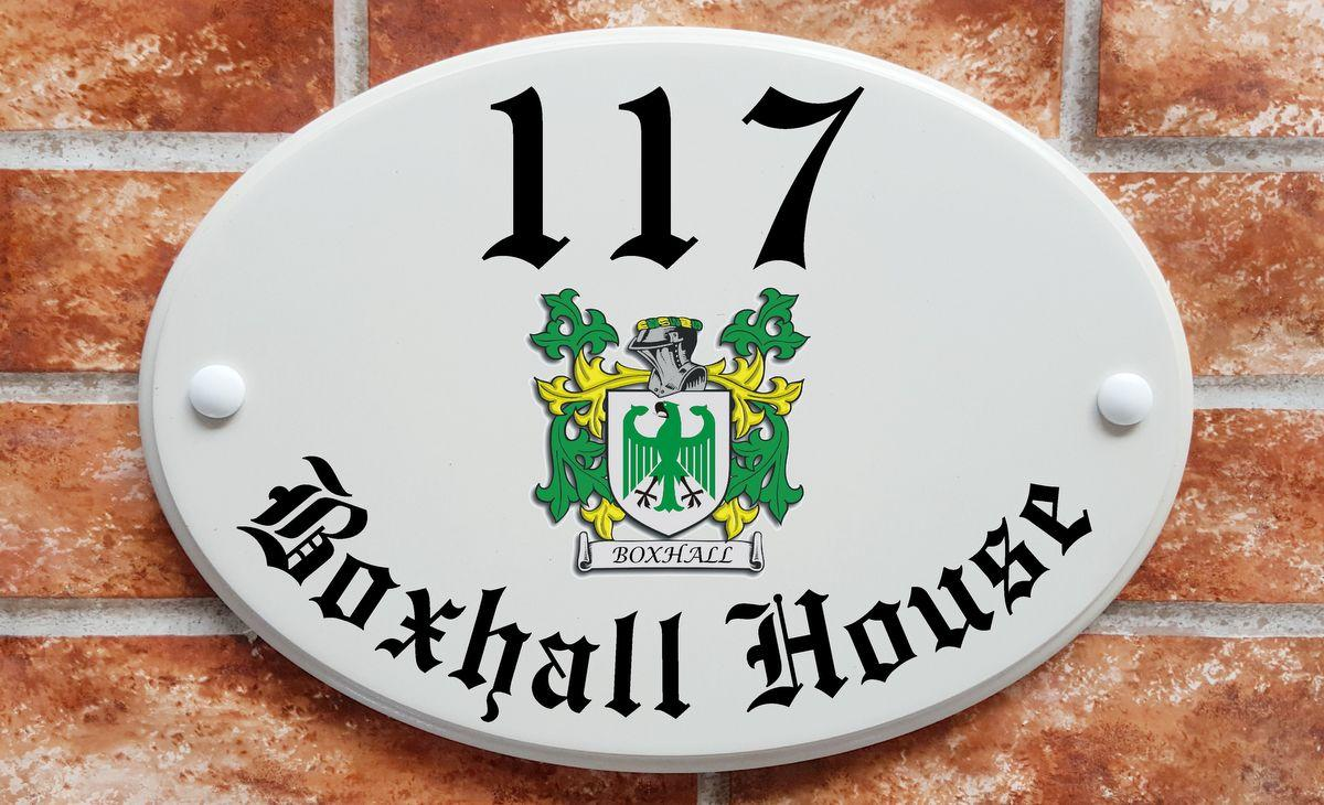 house name plaque with heraldic family crest