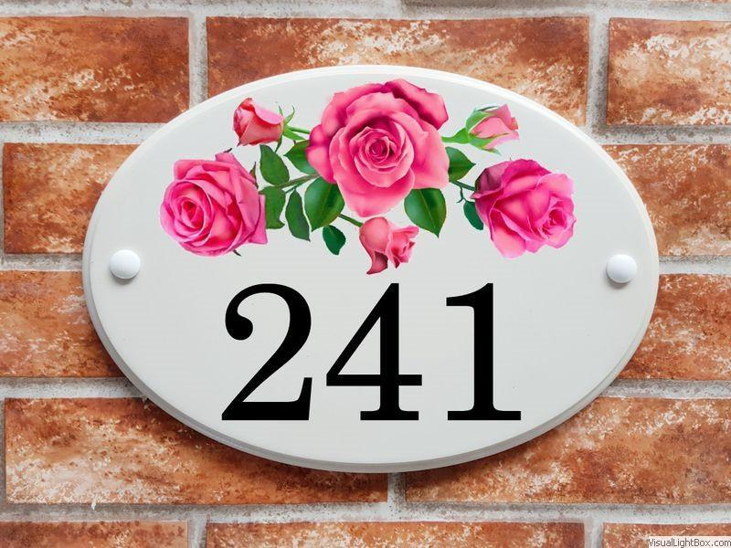 Large house number sign with roses