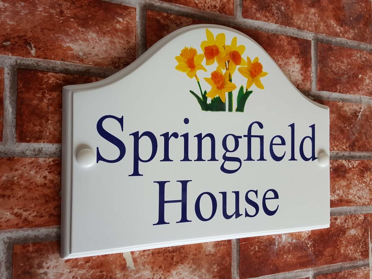 Daffodils picture house sign with house name in blue text