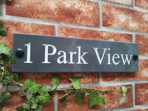 Slate house sign with address line and white inlay