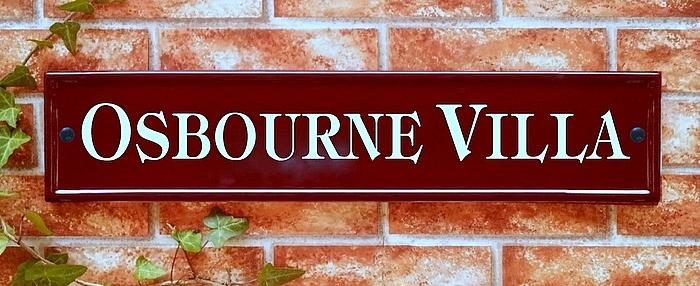 Large name plate in burgundy with Osbourne Villa