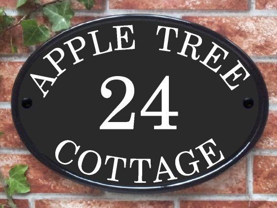 Large oval house plaque in black with house name and number