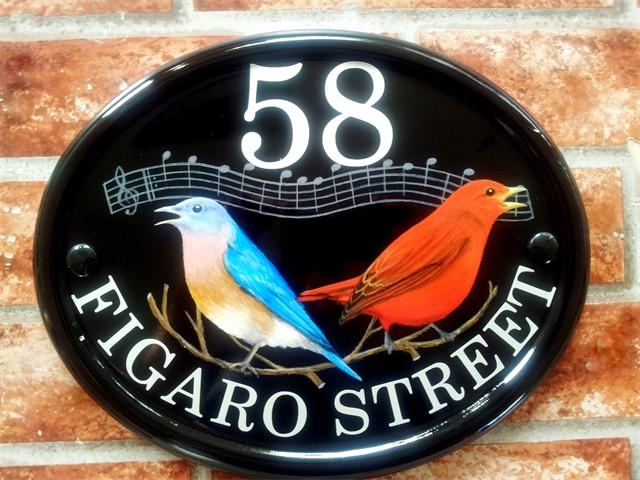 Singing birds sign