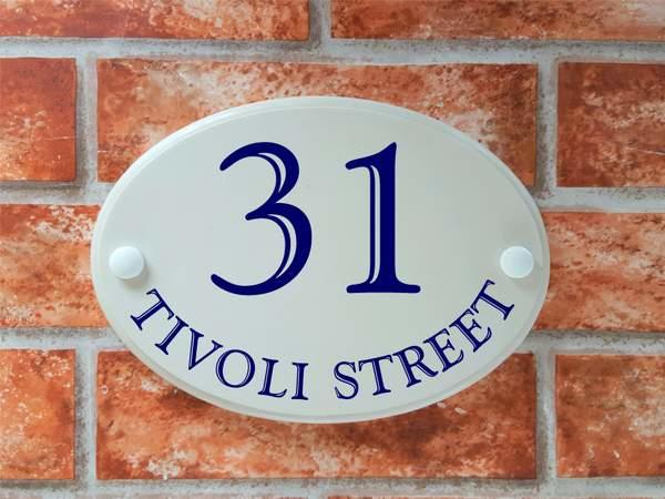 house plaque with coloured numbers and text