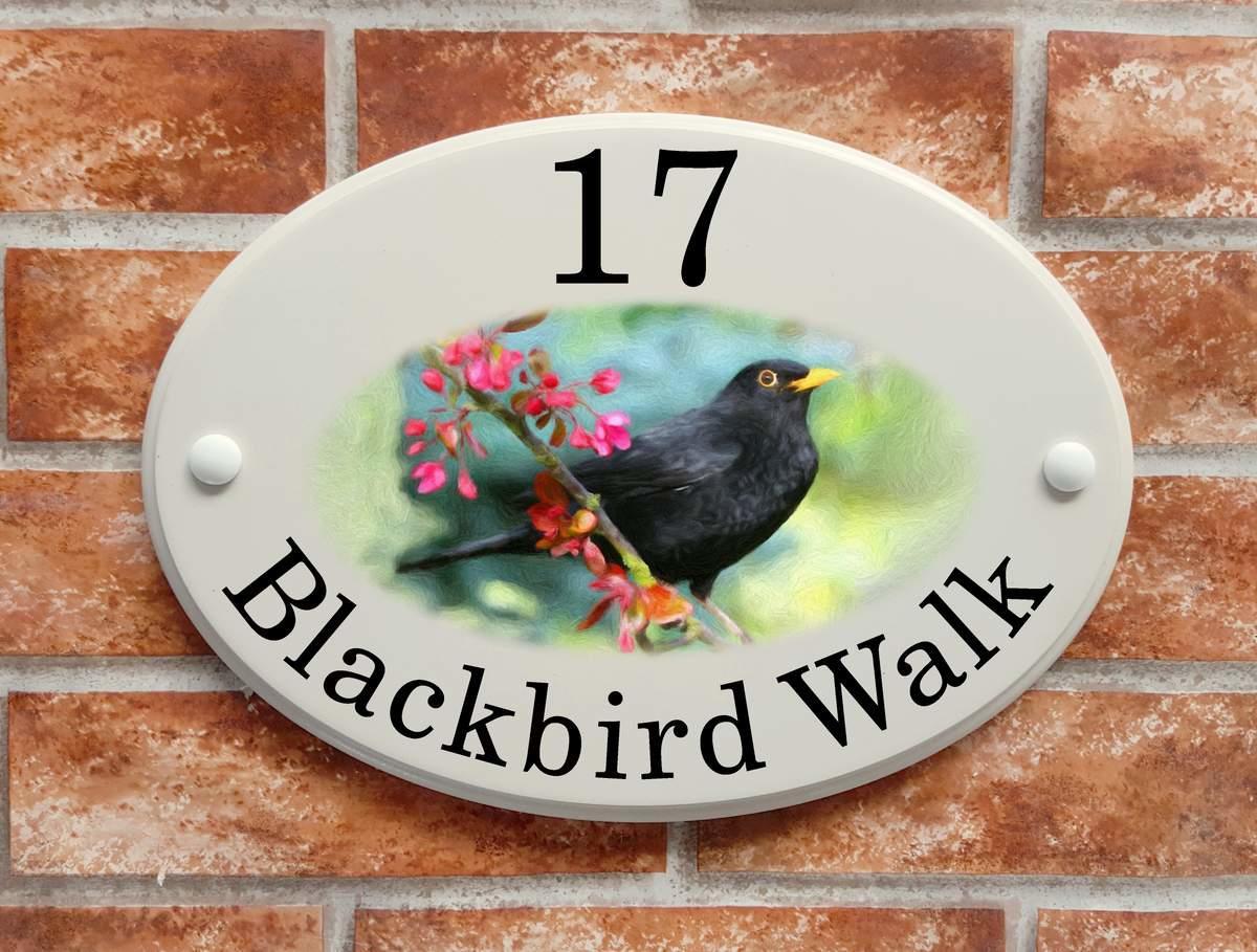 Blackbird and blossom house plaque