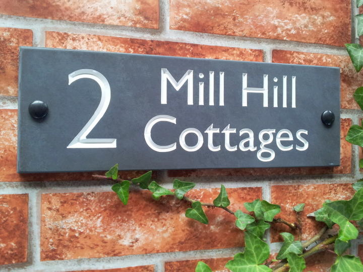 Slate house sign with large number and address line and white inlay