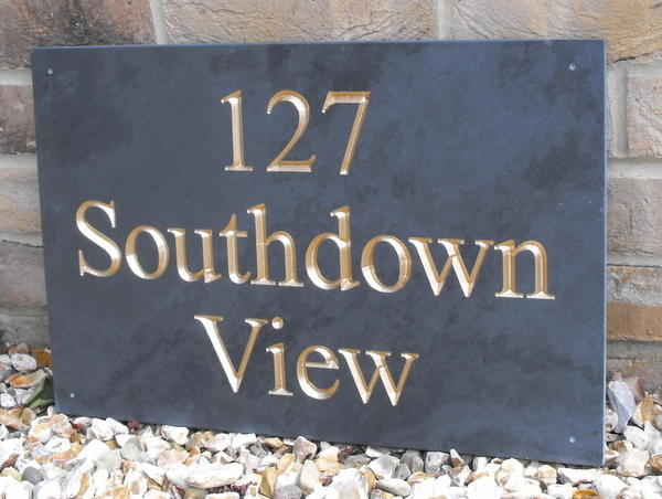 Slate sign with address and gold inlay