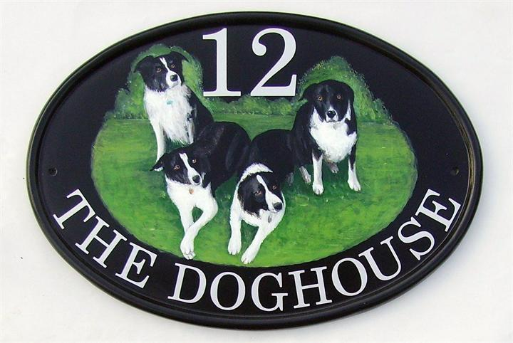 Collies on house sign