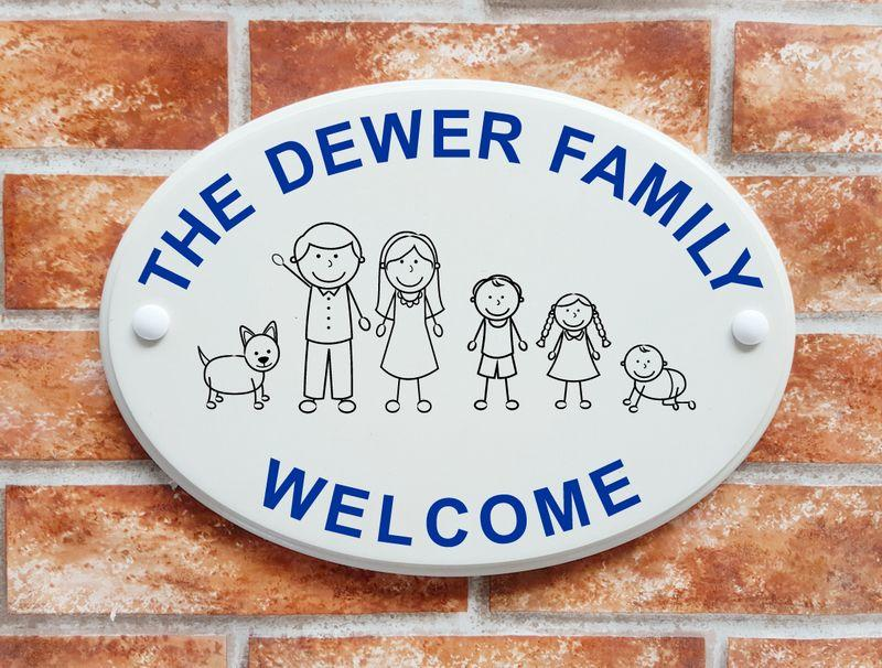 Welcome sign with stick family