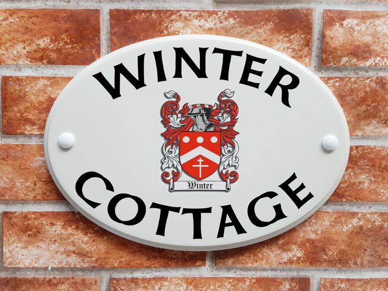 House name plate with Winter family crest