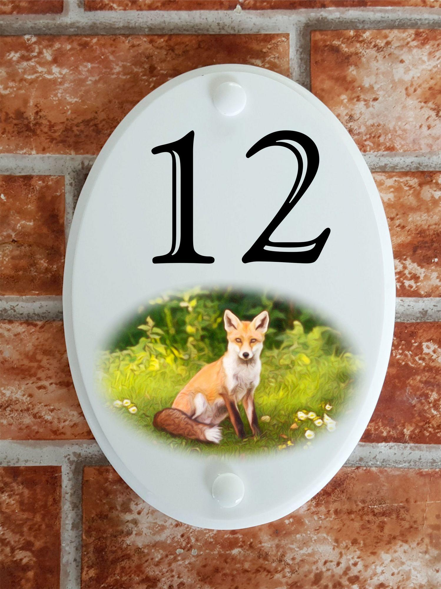 House number plaque displaying a fox motif picture