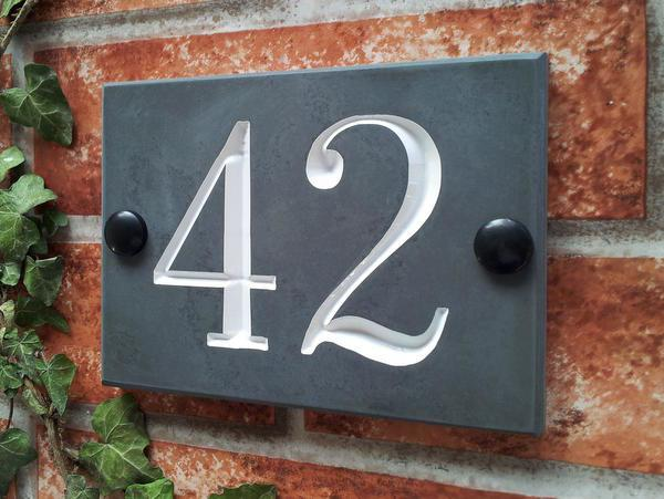 Slate house number sign displaying 42 with white inlay