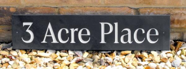 Solid slate sign with white inlay