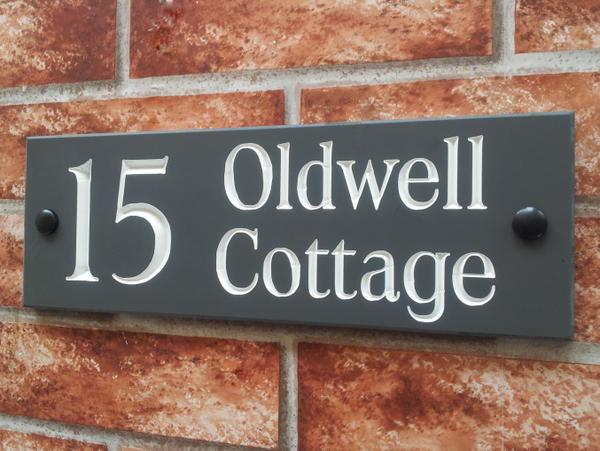 Home address marker with white inlay and large number