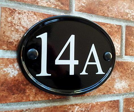 Oval house number sign with 14 A