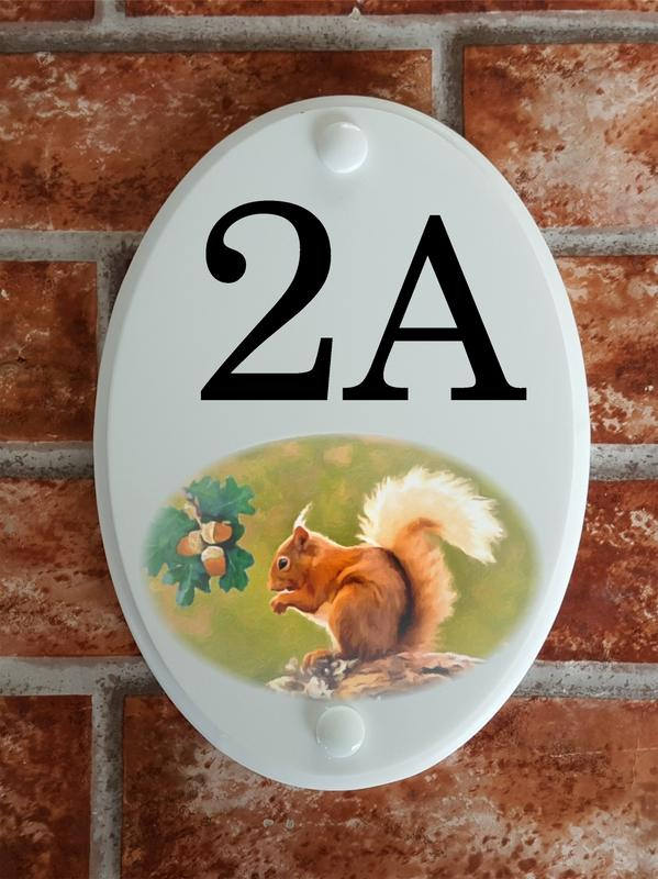 House number plate with squirrel picture motif