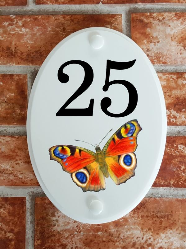 House number sign with peacock butterfly picture motif
