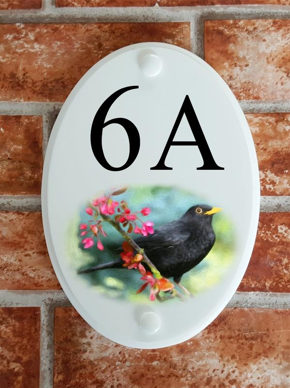 House number sign with a blackbird picture motif