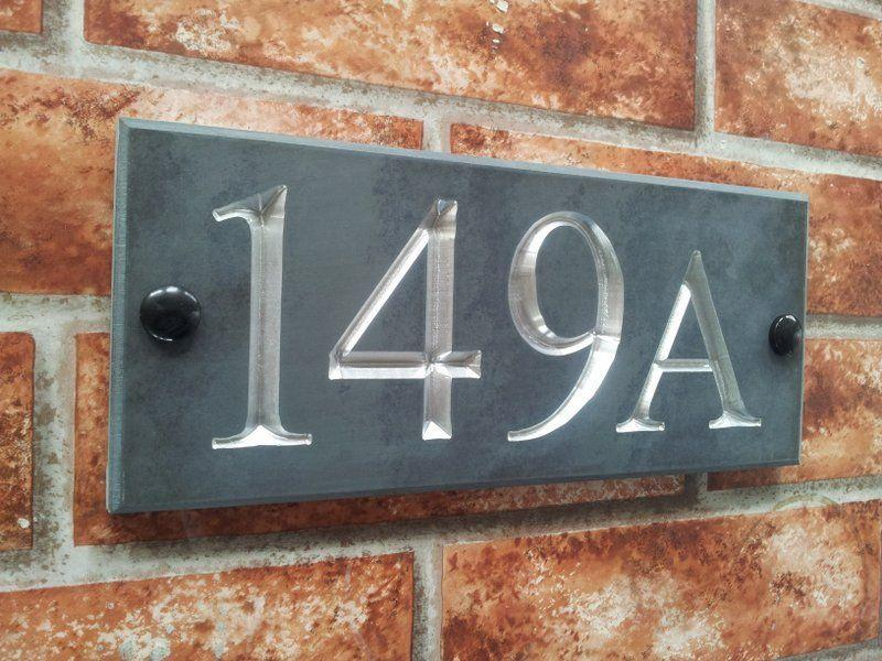 Slate number sign displaying 149A with chromed silver inlay