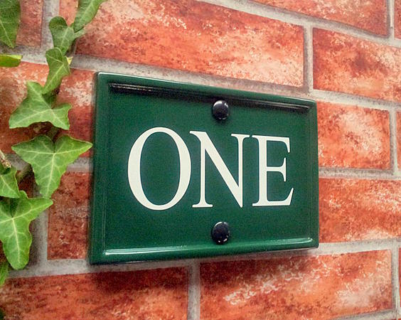 Green house number plate in green with written ONE 180mm x 124mm