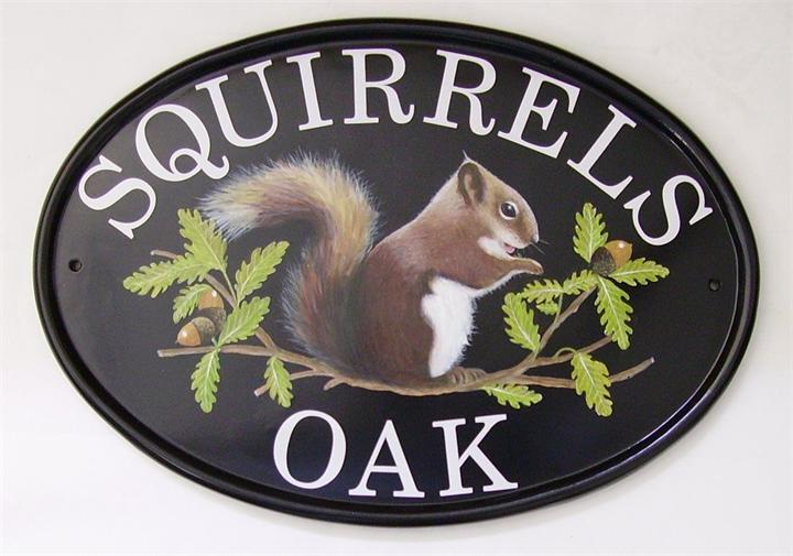 Squirrel and nut sign