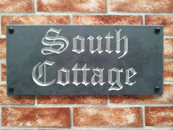 Slate name sign with chromed silver inlay