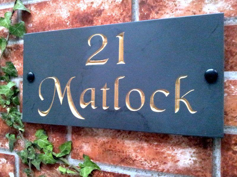 Slate name sign with gold inlay