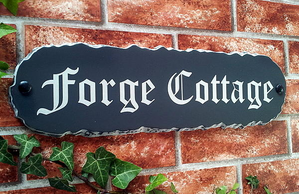 Rustic house name sign with Forge Cottage