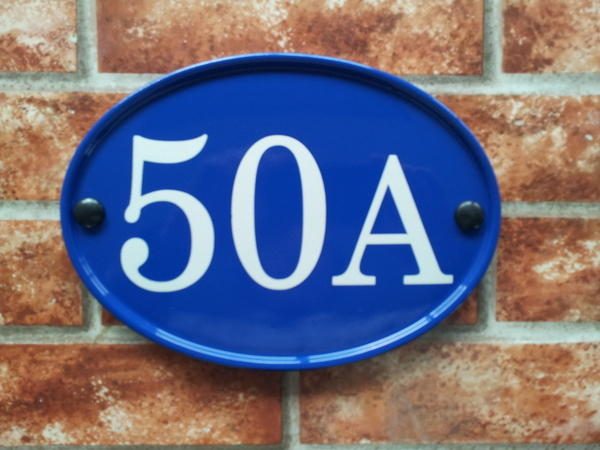 Large house number in blue with 50A