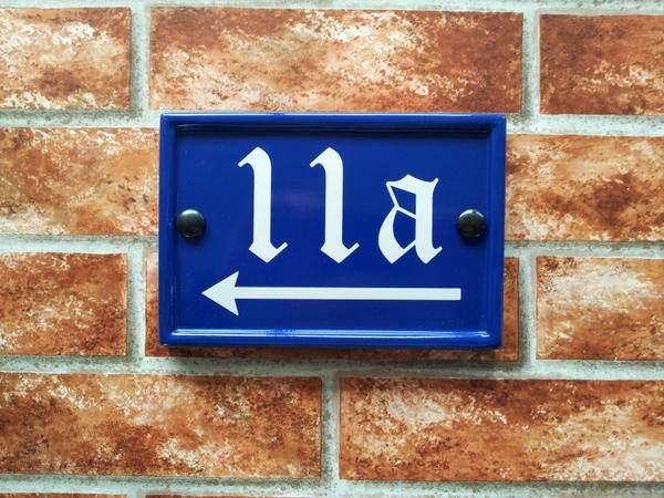 Blue rectangular sign with number 11a and directional arrow