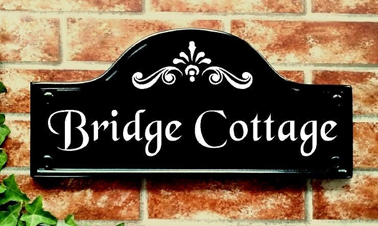 Bridge top illustrating Bridge Cottage in night reflective text