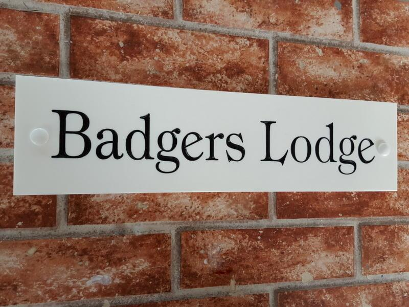 Example with Badgers Lodge in tiffany medium  font