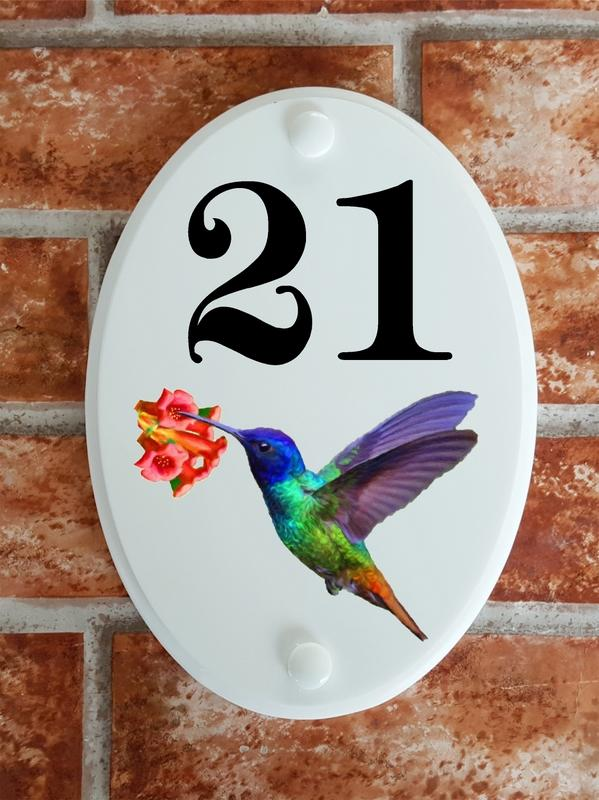 House number plate with a hummingbird picture motif