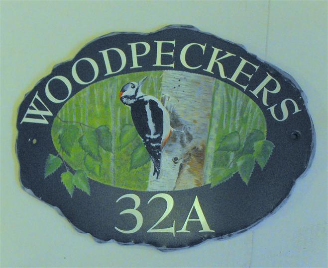 Woodpecker house plaque