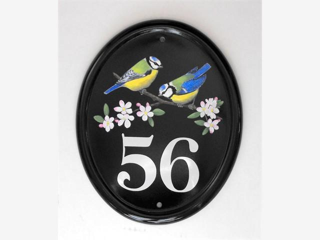 Two bluetits house number plate