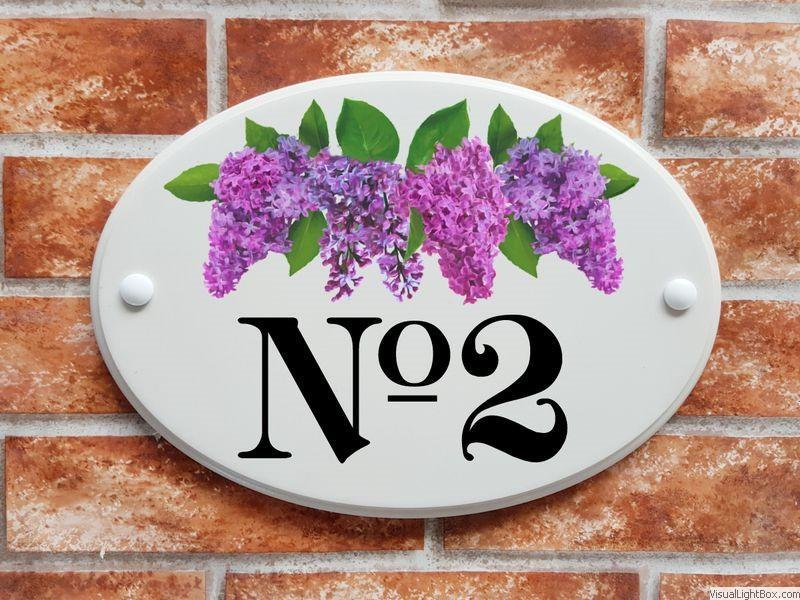 Large house number sign with lilac