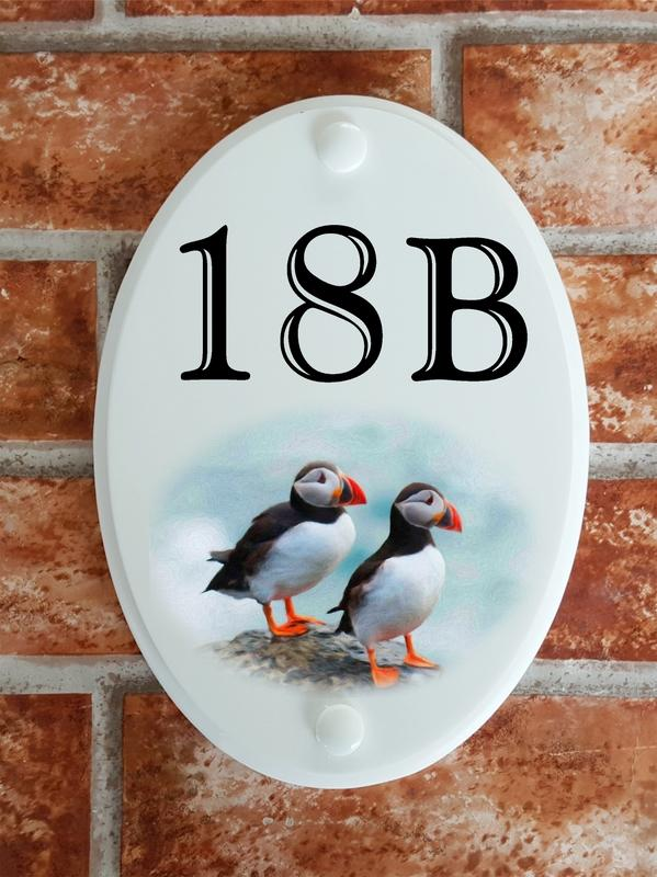 House number sign with two puffins picture motif