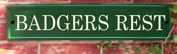 Green house plaque with Badgers Rest