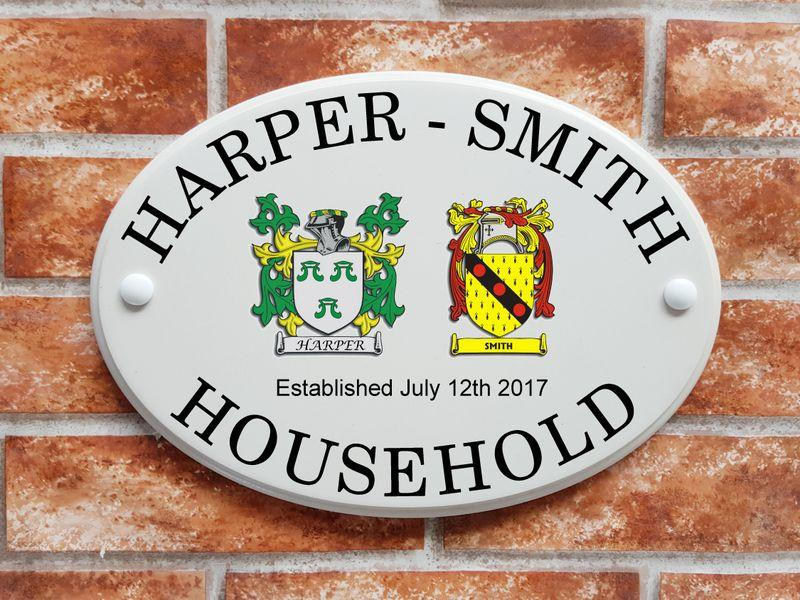 house sign with 2 family crests